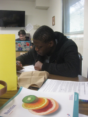TJ studying hard for the upcoming Nutrition test