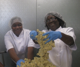 Tenishia and Linda gettin their hands in the dough!
